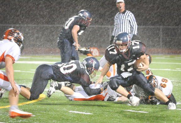 UNION MINE'S Sean Tow breaks upfield Friday thanks to blocks from Dan DeRosa, No. 50, and Paxton Fitzpatrick, No. 60, in the D'backs' victory over Marysville. Democrat photo by Shelly Thorene