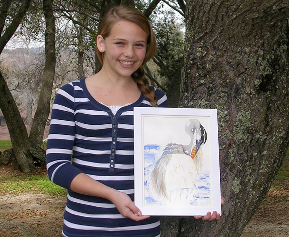 SOPHIE HILL, 12, is the Best in Show winner of the 2012 Young at Art completion, held at St. Francis High School in Sacramento. Here, she holds her winning entry, a pencil, pen and ink, and watercolor painting of a preening crane. Photo by Susan Laird