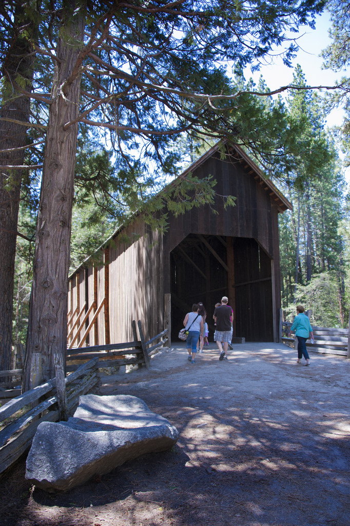An historic covered bridge crosses the Merced River.